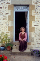 Michèle Roberts sitting in her garden